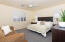 Huge master bedroom with two sunny windows,