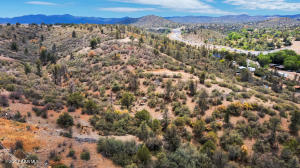 This buildable hillside homesite will have wondrous views in different directions located at 1066 N Turquoise Drive 604 Prescott with power and water on a paved road. Nice!