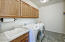 This oversized laundry room comes equipped with the Maytag Neptune Washer & Dryer. Not seen is also a double wide closet to serve as an additional pantry or storage.