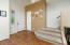 Tiled Entry Foyer with Plantation Blinds, Tile Flooring, Large Coat Closet, 2 Tone Paint, Tall Ceilings & 8' Entry Door.