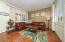 Main Floor Living Room with Plantation Shutters & Drapes, 2 Tone Paint & Pergo Flooring.