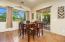 Gorgeous Views Here! Tiled Flooring, Drapes & Accordion Window Treatments.