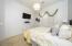 with Designer Lighting, Sunny Side Window with Sheer Drapes, Carpet Flooring & Sliding Door Closet.