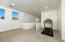 with Large Deep Storage Closet, Recessed Lighting, Carpet Flooring & Sunny Windows.