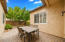 Serene Side Courtyard with Iron & Block Fencing, Paver Patio, Mature Shade/Fruit Trees, 2 Raised Flower Planters and lots of Bird Watching!