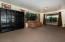 Lower level living area and exit to garden and patio.