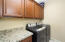 with Washer & Dryer Included, Granite Folding Counter, Tile Flooring + Upper & Lower Cabinetry.