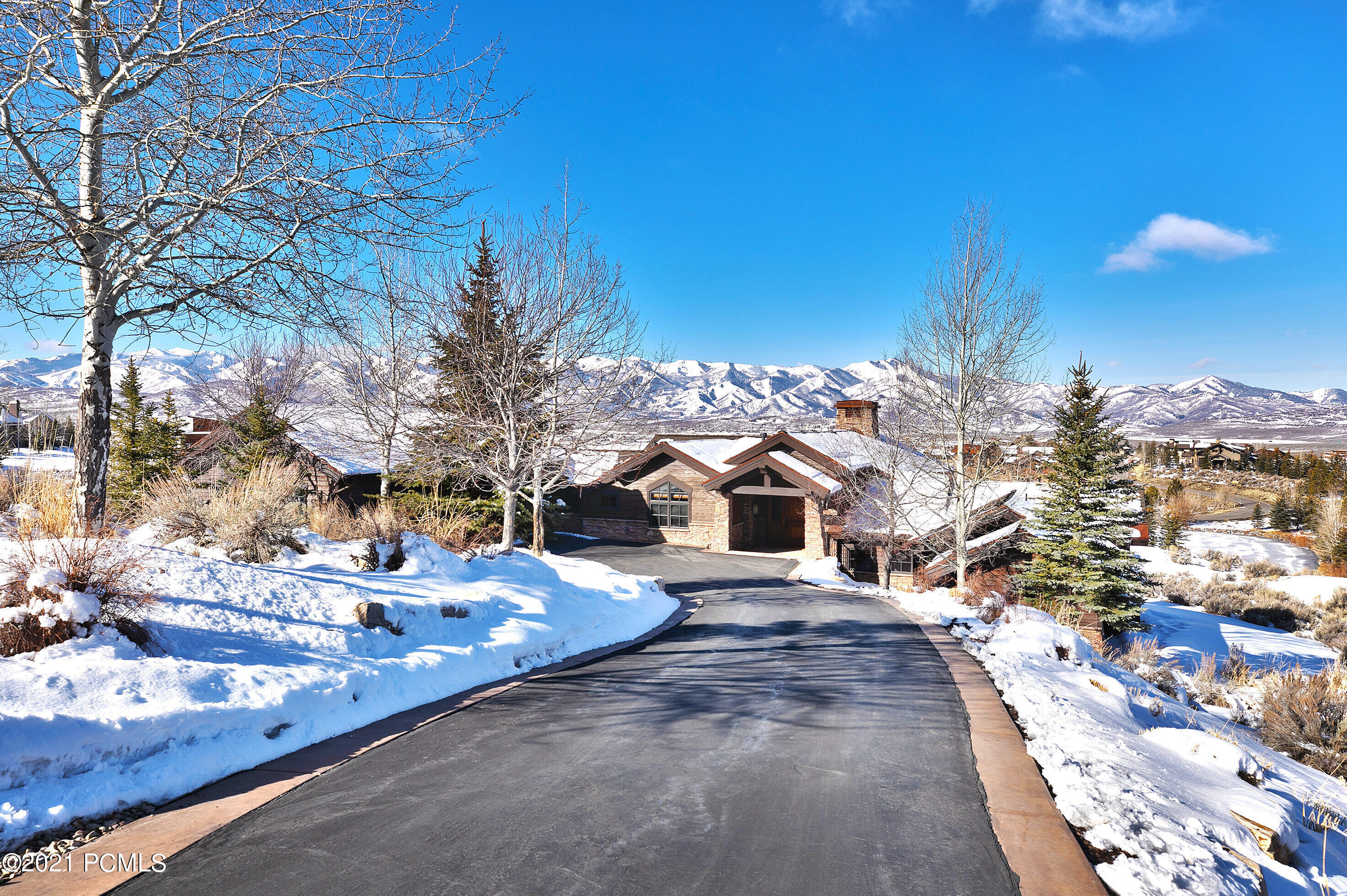 Great location overlooking the 4th green of the Dye golf course in the West View neighborhood.  Enjoy the beautiful sunsets and unobstructed golf & ski resort views from the large, covered deck with an outdoor fireplace.  As you enter the front door, you are welcomed by a great room with a floor to ceiling stone fireplace and an open floor plan perfect for entertaining.  Kitchen includes high end Viking and Sub-Zero appliances and large granite island.  Spacious owner and guest suites on opposite sides of home offer privacy.  Walkout lower level showcases a family room with another floor to ceiling stone fireplace, wet bar and 2 en suite bedrooms. Additional features include a lower patio with a hot tub & fire pit.  You will appreciate the home audio system and heated oversized 3 car garage with epoxy floors.  Very convenient location to the many club amenities including the beach club, tubing hill, pools, spas, gym, tennis, pickle ball, golf club houses, kids' cabin, Equestrian Center and the Shed, which features indoor basketball, bowling & a theater.