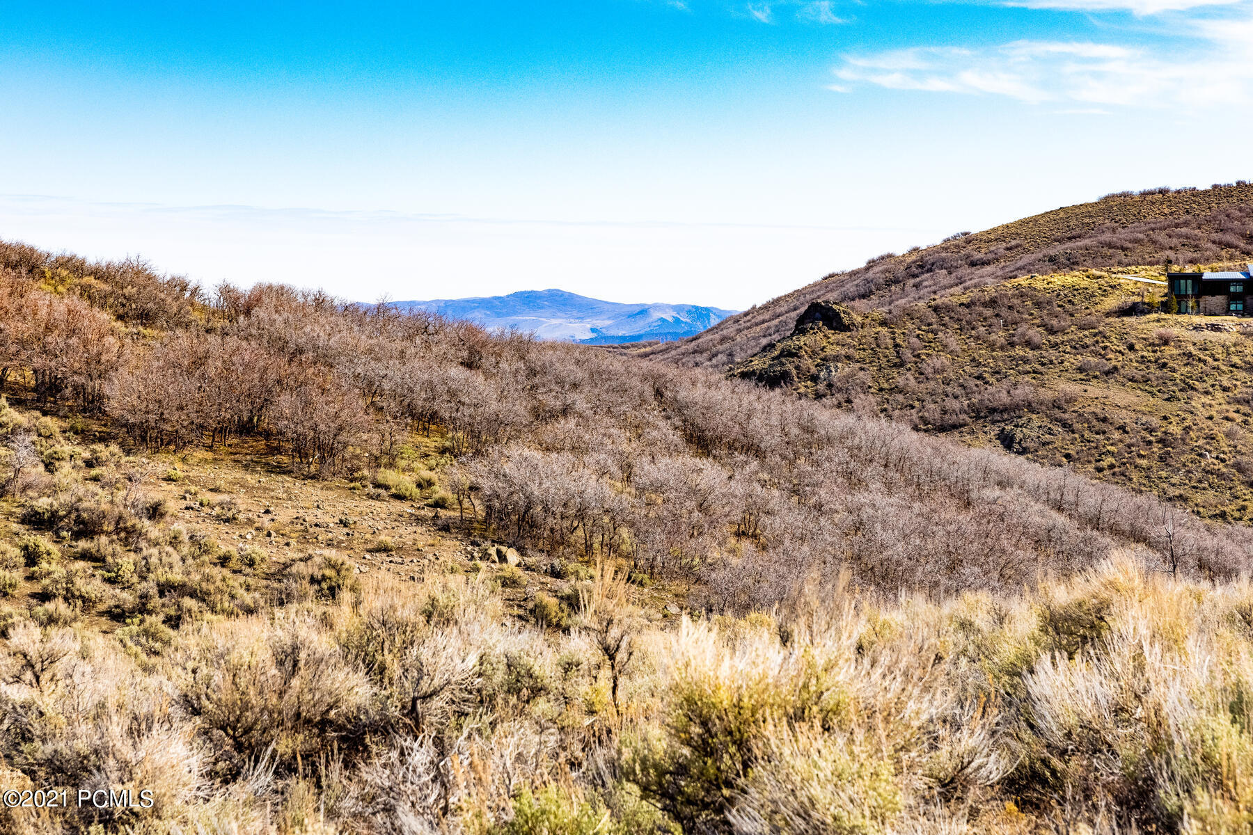 This beautiful homesite located in the Buffalo Jump neighborhood is the perfect spot for wonderful memories yet to be made. With quick access to Promontory's main gate off I-80 with our own exit, you can be in Park City in minutes, and to the Salt Lake City Airport in 30 minutes. Promontory's 40-plus miles of private multi-use nature trails will allow you to connect with the great outdoors or get you to the many amazing Promontory amenities and Pete Dye Golf course. Promontory is Park City's premier golf and recreational community, with members enjoying a private Alpine Ski Lodge and transportation to Deer Valley and neighboring ski resorts.