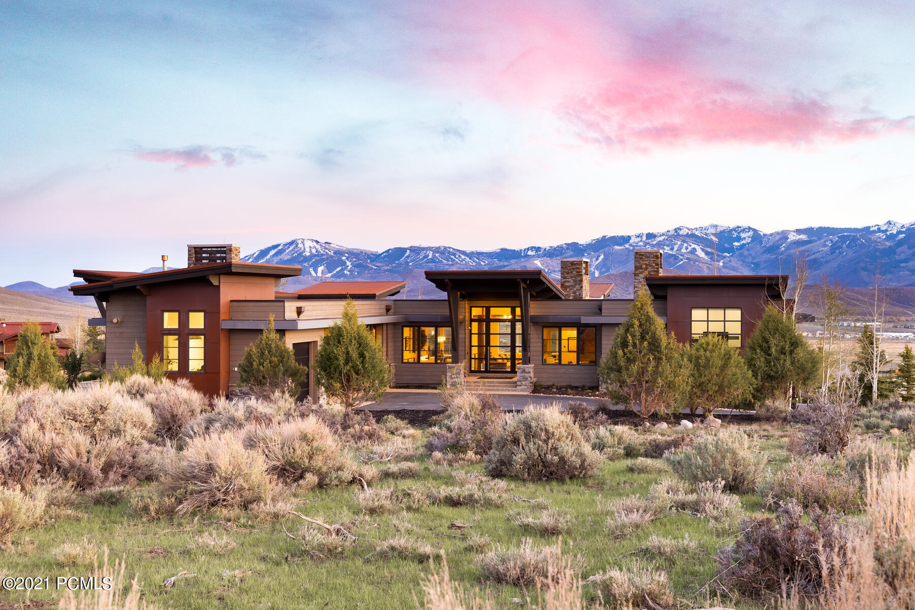 Enter into this exquisite mountain contemporary masterpiece and immediately be struck by the panoramic views from Deer Valley to the Olympic Park, showcased through the incredibly intentional open floor plan and displayed in every room. The lot was picked because of its SW orientation, with walkability to the clubhouse and amenities, and its placement on the 7th hole of the Pete Dye Signature Golf course. All seasons entertaining is made easy when your chef's kitchen is the heart of this open concept. Mingle and prepare everything from a feast to a simple snack with state of the art double ovens, steam oven, outdoor kitchen, double island, and hidden pantry. Custom La Cantina doors open from the nook living room and the dining room to covered, heated decks where you can spend the evenings dining under the stars and then roasting marshmallows around the glowing fire pit. Enjoy main level living featuring a master suite and second guest suite. Four additional bedrooms, family room, game tables are on the lower level as well as a wine room and home gym. Experience the ultimate mountain lifestyle with the Promontory clubs 14 incredible amenities, while enjoying the privacy and serenity of this exquisite home.