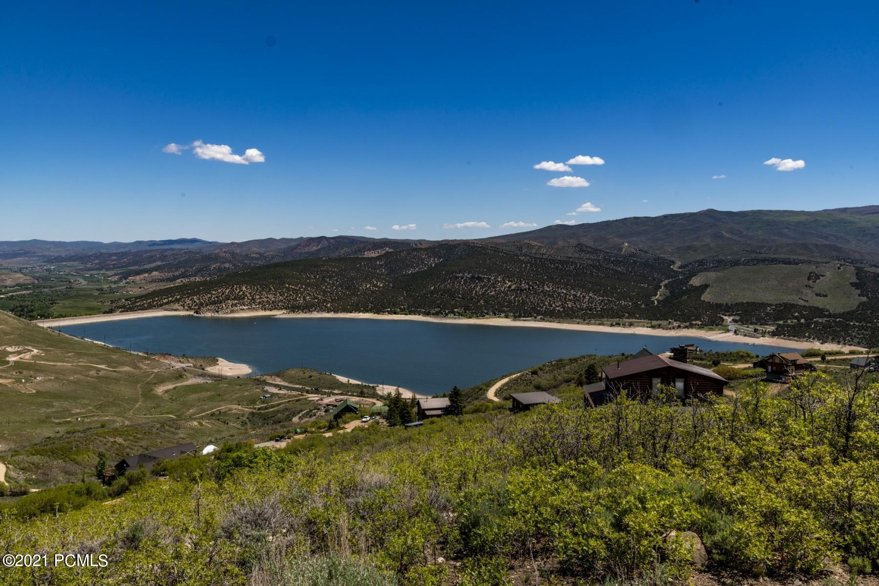 You will find this stunning lot with spectacular lake and mountain views in Rockport Estates, a gated community that is only 20 minutes from Park City with easy access to I-80 or scenic Browns Canyon. The ideal location for year around beauty and recreation with spectacular views. Build your dream home now!