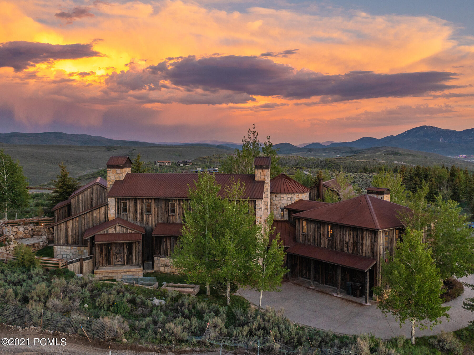 This timeless, stunning home was designed by Clive Bridgwater, one of the more renowned Utah architects, on one of Promontory's best lots in a central location with large ski resort views. The home's spaces are thoughtfully designed to be open while simultaneously providing gathering spaces throughout the home. The sophisticated great room has steel beams, two dramatic fireplaces and large windows opening to the outdoor living spaces and Deer Valley Resort views. The large kitchen is a chef's dream with professional appliances, a large pantry and beautiful windows to the hillsides bringing in a significant amount of light. The master suite is spacious with a fireplace and seating area, his & hers closets, a steam shower and soaking tub. This area is private and offers more views to Park City Mountain Resort. There's also a guest wing for additional privacy with two spacious bedrooms both with dedicated bathrooms. Additionally there's a guest home currently used as an office and an art studio.  This area has an additional bedroom that could be separated into two bedrooms if desired. It has two more fireplaces, a bathroom and a separate entry. The home is adjacent to Promontory's trail system for an easy walk to the mountain garden park and pond or to Promontory's amenities such as the swimming pools, golf, tennis, fitness, spa or dining areas. The home has recently been painted and furnished with new designer furnishings. Once you step in this home, you'll appreciate the workmanship and the location and want to call it home.