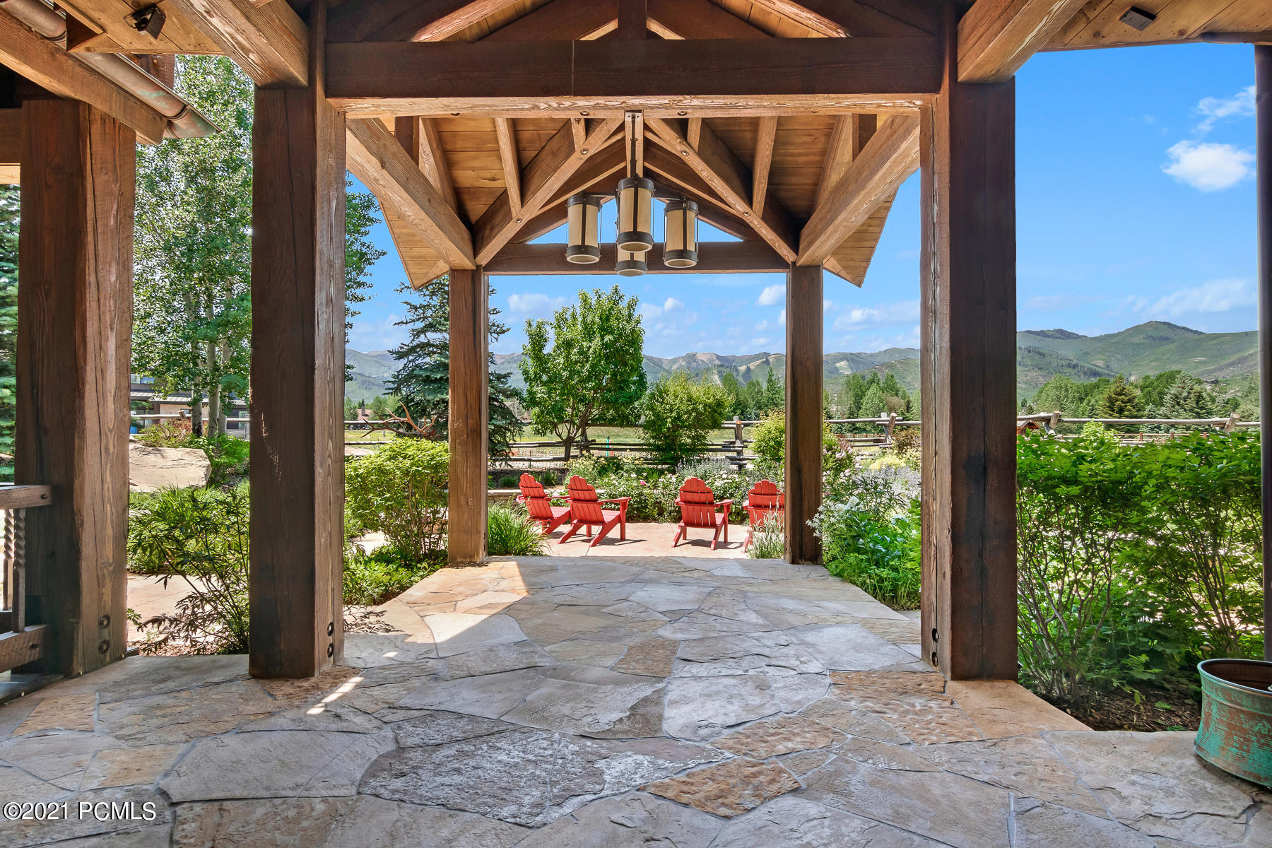 Park City Utah Legacy Home surrounded by vast open space and wide views of the Wasatch Mountains. Quiet. Private. Light. Sophisticated styling by Barclay Butera. Many indoor and outdoor gathering spaces: vaulted great room with pass through fireplace to formal dining; Entertainment Room with bar, pool, shuffle board, comfy TV area; Outdoor deck with chefs grill, sink, comfy seating, hot tub and fire pit; Breakfast room and fireplace room surround a large gourmet kitchen featuring Wolf and SubZero doubled appliances. Unique features include a historical trestle wood, glass walkway, 3 balconies on the second level, stunning water features and grounds, a pergola with custom crafted log picnic table. 5 Car garage with 16' insulated door. Plus a 16' rec vehicle garage. 2 stable horse barn. Gated private driveway. All connected by a radiant heated courtyard. 5 bedrooms. 9 baths. 10 fireplaces. Minutes to Park City, Salt Lake City and Airports.