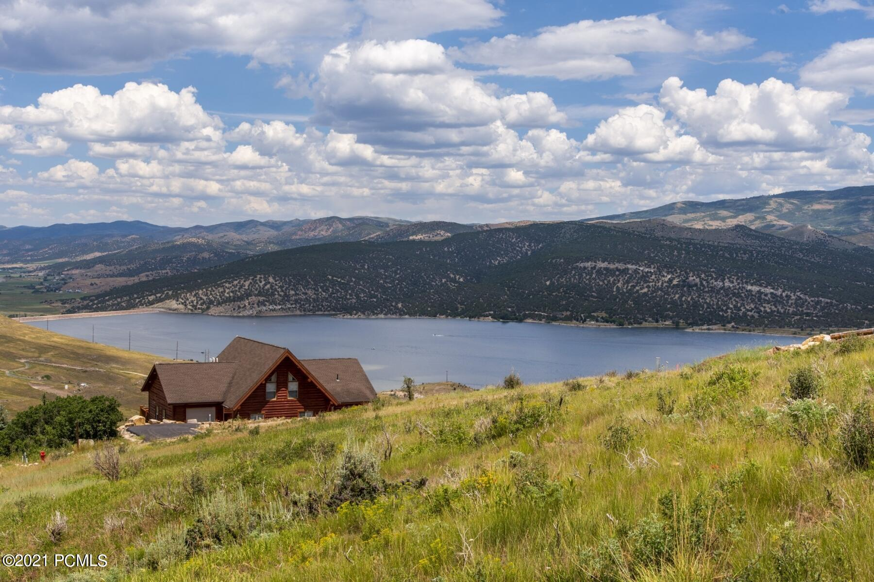 You will find this spectacular 1 acre view lot in Rockport Estates, a gated community that is only 20 minutes from Park City with easy access to I-80 or scenic Browns Canyon. The ideal location for year round beauty and recreation as it is quick access to playing on Rockport Reservoir, just minutes to  world class fly fishing on the Weber River and less than 30 minutes to 3  ski resorts! This location is perfect for mountain living with easy access to everything you need!