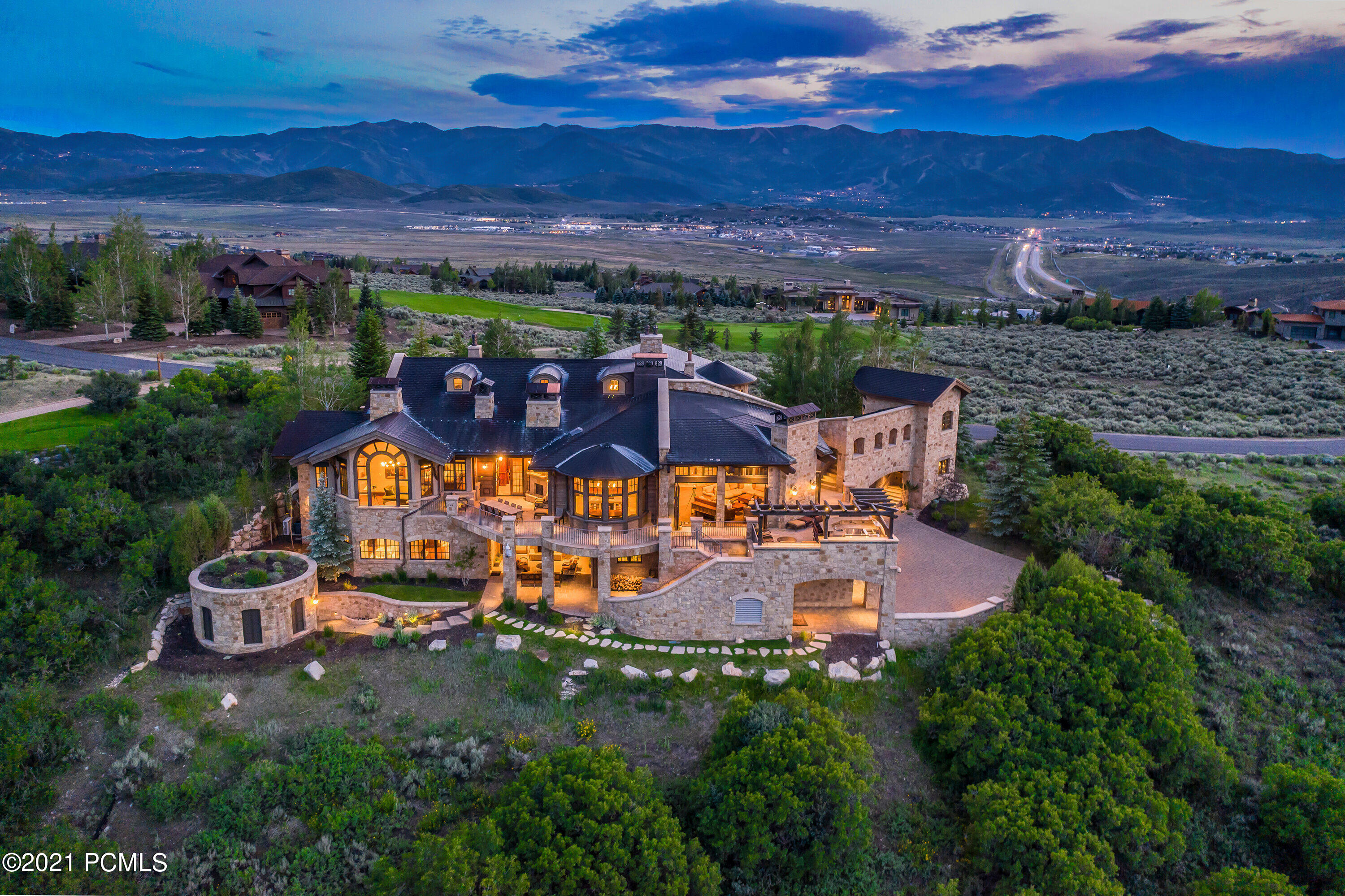 Villa del Alce - This European estate is extraordinary in every way. Situated on an epic panoramic view lot overlooking a canyon known for migrating elk in the premier gated community of Promontory Ranch Club in Park City, Utah. This inviting home was designed and built seamlessly for family, work or play, with a thoughtful layout promoting a natural flow and true year-round indoor-outdoor living. No expense has been spared, no detail overlooked, featuring handcrafted Biblical stone imported from Israel, 200-year old beams reclaimed from Midwestern barns, Italian stoned ceiling painstakingly hand cut piece by piece with hand carved wood throughout. Enjoy intimate moments with family and friends or entertain up to 100 guests easily with an open authentic European kitchen including an Italian wood-burning pizza oven and complete with a La Cornue range found in the best restaurants in Paris. Other amenities are fully connected smart system, golf simulator, a grotto with 12-person hot tub, waterfall, Kaleidoscope movie system, guest home, and year-round usable outdoor dining area. Promontory Ranch Club is a 6,300-acre resort lifestyle community that offers entertainment for all 4 seasons, featuring 2 golf courses, ski cabins, spa, multiple world class restaurants, private beach area, tennis etc. 15 minutes to historic Park City and Deer Valley, 35 minutes to Salt Lake City International Airport.