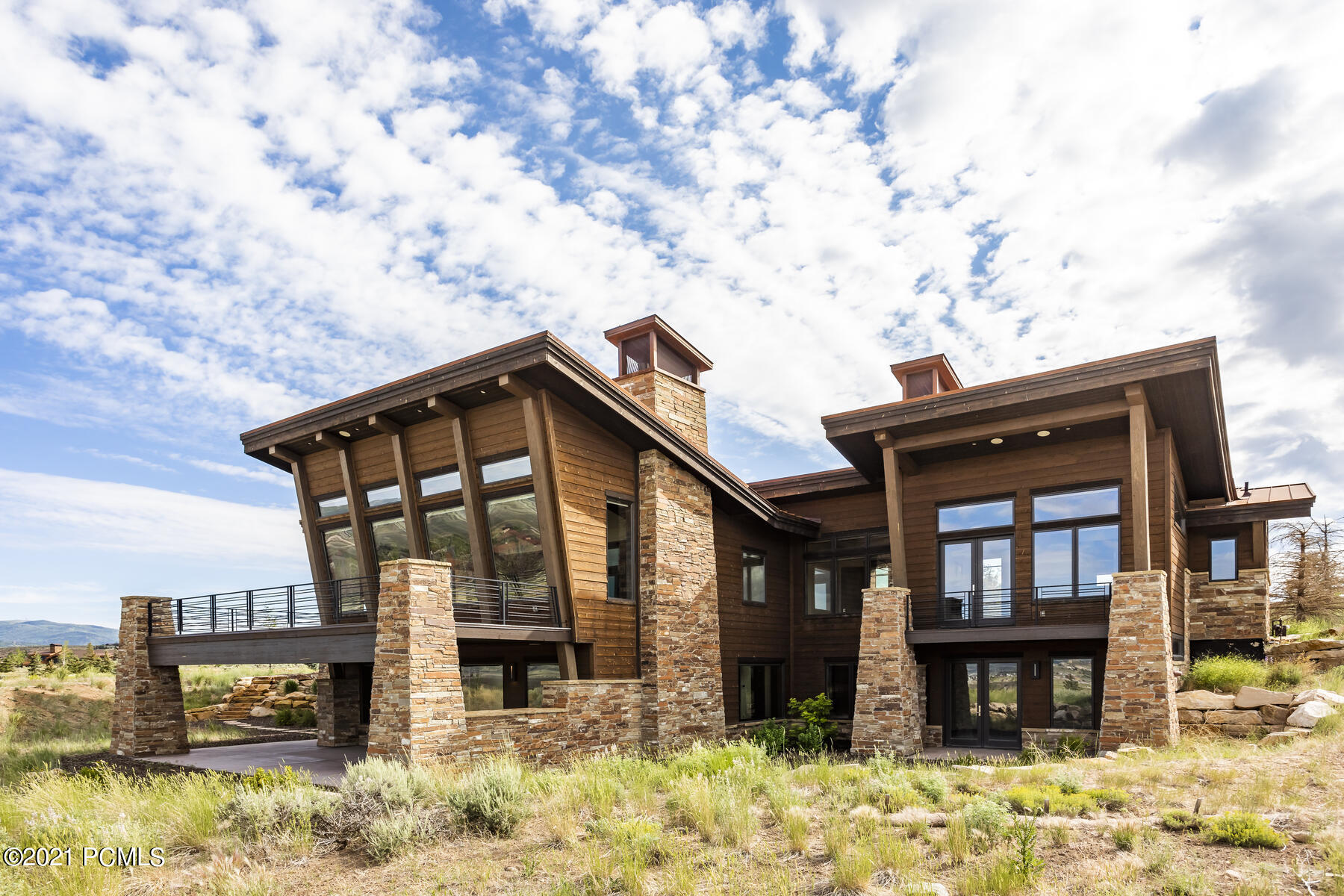 This fantastic mountain contemporary estate was designed with the outdoors in mind to capitalize on the panoramic views of Park City's three world-class ski resorts. The vaulted ceiling, oversized windows & la cantina sliding wall facilitate the ultimate in peaceful mountain relaxation. Features include chef's kitchen, thoughtful open floor plan, main level living, oversized windows for abundant light, and an extensive theatre with wet bar and lower level walk-out designed for year-round entertaining. Situated in Promontory, this private gated golf club and residential community feature 2 world-class golf courses, spa, workout facilities, kids cabin, multiple pools, outfitters cabin, and equestrian facilities, several clubhouses, five restaurants, and its new addition, the Promontory Beach House. This home is a must-see for the ultimate in luxury and amenities. Golf Membership available.