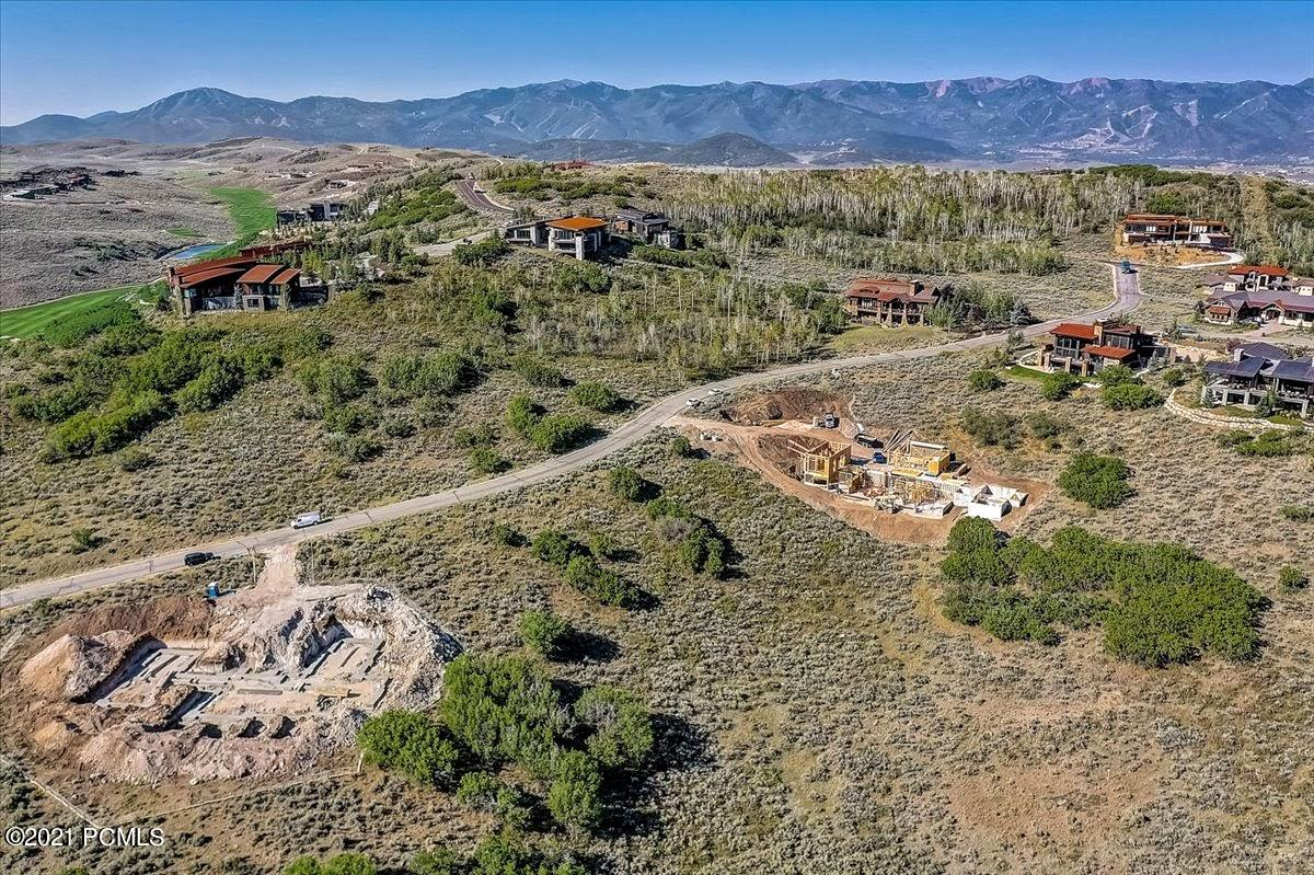 Centrally located within one of Park City's most coveted areas, this Aspen Camp parcel offers the opportunity for a downhill build on 1.07 acres.  Here you will enjoy viewing elk, deer, and other wildlife as they meander through the area while having breathtaking views towards Wyoming and the majestic mountains and only a short drive to Park City's Main Street. Promontory is a private gated community on 6400 acres with luxury-level amenities.