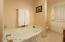 full bath with separate tub with convenient door to pool area