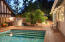 large brick patio around pool for lounging
