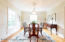 Formal dining room with hardwood floors and wainscoting