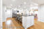 Kitchen with hardwood floors and breakfast counter