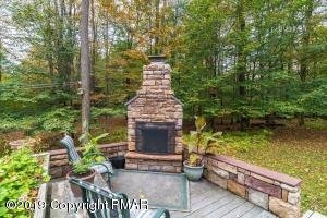 Great outdoor space! Fireplace, trex decking, and privacy!