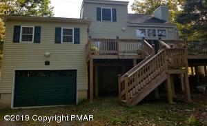 Front of the house view. You have a large deck with drive in garage. Enter from garage, backstairs or upstairs.