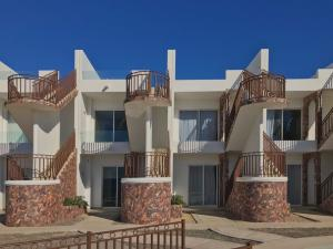Second Row Ocean View Condos in Las Conchas gated Beach Community Beautiful 3 Bedroom & 3 full Bathrooms with a private Garage underground