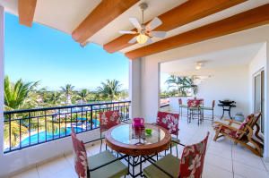 Beautiful covered terrace overlooking the Marina, gardens and pool
