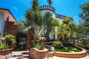 Inspired by historic Mexican haciendas from yesteryear, Villa Santa Fe continues the tradition of the proud national architecture by reviving this distinct craftsmanship inside the exclusive Colina Encantada residential community. Lavishly designed throughout, the five-bedroom, seven-bath Mediterranean style residence combines comfort and luxury with charm, elegance and functionality, while maintaining the warm tones of its natural hillside surroundings. Quality amenities & attention to detail can be seen on all three floors, with commanding arched walkways, 4 waterfalls, multiple Jacuzzis, steam room, designer glass fixtures & large ocean view en-suites built with imported granite & marble.  A stunning home like no other, Villa Santa Fe is an extraordinary 8,751 sq. foot estate.
