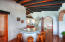 Kitchen with bar under authentic terracotta clay tile roofline