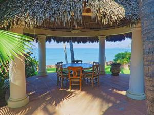 This spectacular hacienda style property is located on the beach in the ''Golden Zone'' of Bucerias. The little beach town is located just 20 minutes north of Puerto Vallarta International Airport. The property is 1.400m2 of land and 570m2 of construction. It has16m of beachfront. The house has 2 floors, 4 bedrooms, 4 bathrooms, 2 living rooms, a study. There is a large palapa on the front for dinner, and ample room to rest. The rear of the property has a large swimming pool located between natural trees.