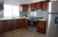 Parota cabinetry, stainless steel appliances