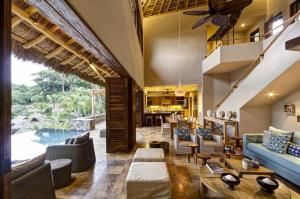 Overlooking the blue Pacific and nested in the tropical jungle, of Mexico's posh 33 acre developent of Punta Sayulita sits Villa Punta Paraiso. A 6000 square foot private ocean view Villa that continually Ives up to its name.
