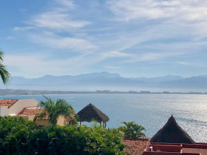 Revel in the amazing views of the Bay of Banderas, ocean and mountains during the day, and the twinkling city lights at night from your nice wide South facing balcony. Excellent floor plan with privacy, great breeze flowing through, and very quiet between floors with solid construction. Nicely furnished and conveniently turn-key. The Punta Esmeralda community has a spa, ocean view gym, restaurant, 2 lit tennis courts, gardens, playground, beach club, 8 infinity swimming pools to choose from, volleyball, walking trails, 24-7 security, 1/4 mile of beach frontage connecting to 7 miles of golden sand beaches. This development is well run, has reasonable fees, and is pet friendly. Comes with an underground parking space and storage room! Easy to rent out when not in use, call us know!!