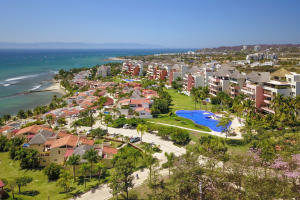One of a kind two-bedroom, two-bathroom, ground-floor unit with beautiful ocean views in Punta Esmeralda. The property offers high-end finishes, upgrades in the kitchen, open floor plan with ocean view from all main areas including the master bedroom, spacious terrace and private Jacuzzi and direct building access to the pool and beach. The complex is located directly on the beach, it offers a beach club, eight pools, extensive green areas and play areas, 24/7 security and gate, administration onsite, full working spa, tennis and pickle-ball courts and a gym. The condo comes furnished and it's pet friendly.