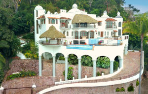 Designed by Legendary Architect JOSE ''PEPE'' MEDRANO GARCIA DE QUEVEDO to be a haven for owners seeking their privacy while enjoying a 270-degree view of the Ocean, City, Jungle and Mountains. This stunning Mexican Colonial stays true to tradition, while blending its Old World styling with modern conveniences for luxurious living in the tropics.Granite kitchen, marble baths, stained glass windows, towering columns, antique carved hardwood doors in master suite & bar area, hand-tiled mosaics, high ceilings, dramatic cupolas, interior elevator shaft to make 3 levels of home access friendly. Parking level has room for 4-5 cars.The Home is currently Unfurnished, is Offered & Sold that way. Furnished & Decorated Photography is provided to give an idea of how it appeared fully furnished.