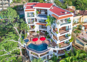 Perched on the Conchas Chinas hillside overlooking the heart of Puerto Vallarta, Villa Divina offers breathtaking views of the Bay of Banderas. This villa could be perfect for everyone: seven bedrooms, pool deck with hot tub, gym, a chef's kitchen and large entertaining areas. Two of the bedrooms have their own pool and large private terraces, all bedrooms with incredible views of the bay and jungle surroundings; plus Villa Divina has a stunning Penthouse apartment that includes two large bedrooms and private pool/jacuzzi and wet bar. This home is the perfect choice for anyone looking for income and a wonderful place to call home. This quality property is not just a great investment, but enjoying time with your family and creating unforgettable memories in Puerto Vallarta can be priceless.