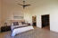 HUGE master bedroom, ensuite bathroom, large walk in quality closet, sliding glass doors that open to backyard, window view of private landscaped area.