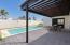 Fabulous yard, view from the outdoor pool shower, 4 door storage just around the corner