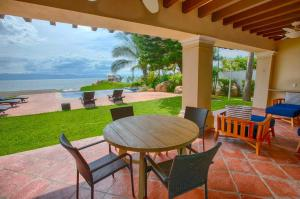 """The private Terrace outside of the living room direct to the private pool and beach (Notice the wall where the beach """"ends"""" making this villa the most sought after for privacy)"""