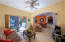 Living area, sliders to pool area