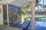 Gorgeous tiled mural behind swim up pool bar..