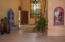 Entry foyer.... LARGE custom stained glass window and water feature.