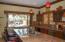 Kitchen bar and pass thru to BBQ patio