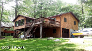 Lovely ranch home with sunroom and expansive deck