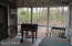 Screened-in sitting area with Grill; fenced yard