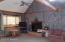 Wood fireplace & Vaulted Ceiling