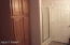 Full Bath with Large Linen cabinet & separate extra shower.