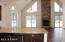 Here you see the view from the kitchen on the first floor. Love that open concept! Straight past the granite countertop peninsula is the open great room with stunning fireplace. To the right is the door to finished basement.